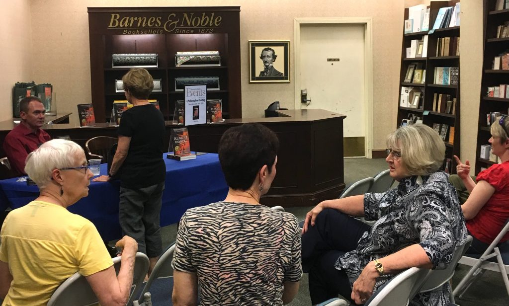 Readers begin to gather to hear Christopher Leibig talk about his newest release, Almost Mortal