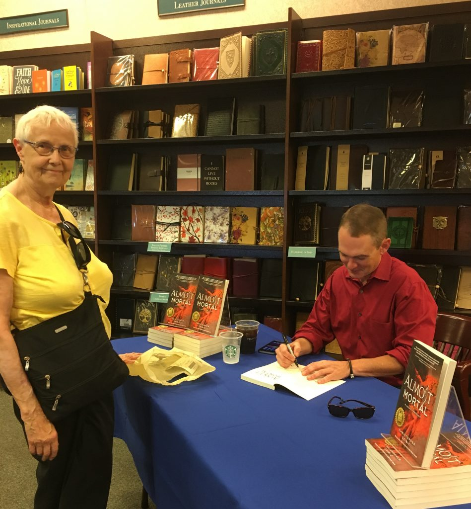 After the talk, Chris stuck around to sign books for readers.