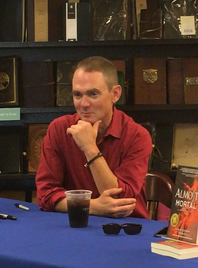 Chris gets ready to address readers and talk about his newest release, Almost Mortal